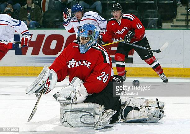 Goalie Michael Tobler of Switzerland gets enough of the puck to make a save on the Czech Republic during the World Junior Championships at the Ralph...
