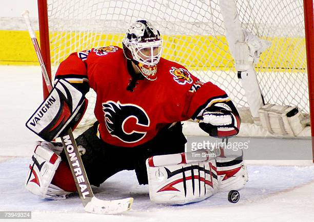 Goalie Miikka Kiprusoff of the Calgary Flames deflects the puck with his pads during the first overtime period of Game 6 of the 2007 Western...