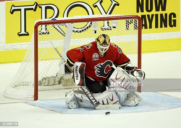 Goalie Miikka Kiprusoff of the Calgary Flames protects the net from the Tampa Bay Lightning in Game six of the NHL Stanley Cup Finals at the...