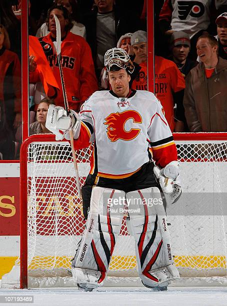 Goalie Miikka Kiprusoff of the Calgary Flames takes a break during a hockey game against the Philadelphia Flyers at the Wells Fargo Center on...