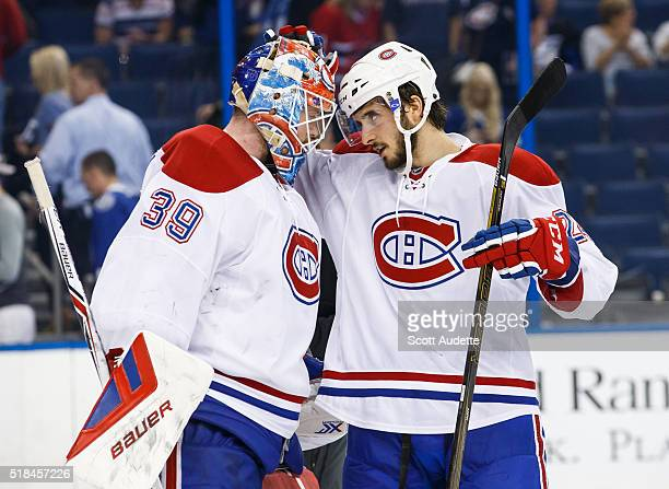 Goalie Mike Condon and Phillip Danault of the Montreal Canadiens celebrate the win against the Tampa Bay Lightning at the Amalie Arena on March 31...