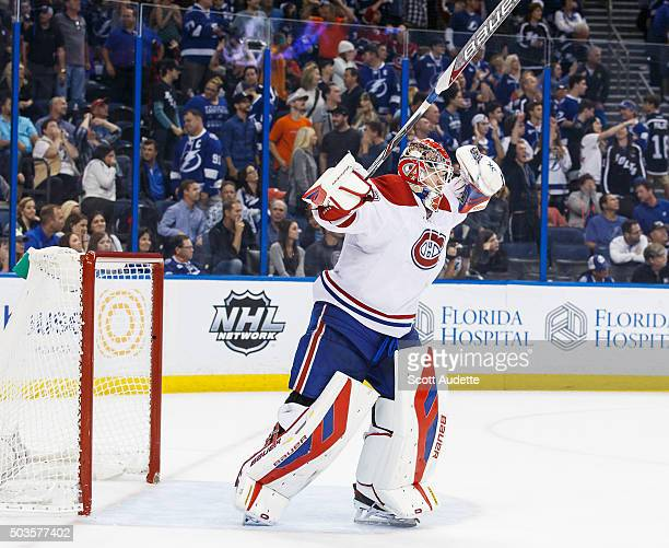 Goalie Mike Condon of the Montreal Canadiens celebrates a win against the Tampa Bay Lightning after the shootout at the Amalie Arena on December 28...