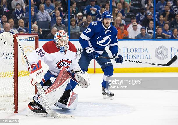 Goalie Mike Condon the Montreal Canadiens tends net against Alex Killorn of the Tampa Bay Lightning at the Amalie Arena on March 31 2016 in Tampa...
