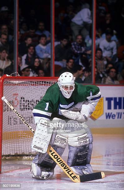 Goalie Mike Liut of the Hartford Whalers defends the net during an NHL game against the Philadelphia Flyers circa 1988 at the Spectrum in...