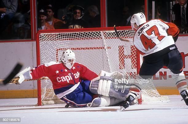 Goalie Mike Liut of the Washington Capitals makes the save on Brad Jones of the Philadelphia Flyers circa 1992 at the Spectrum in Philadelphia...