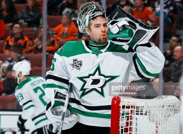 Goalie Mike McKenna of the Dallas Stars drinks from his water bottle while waiting for play to begin during the first period of the game against the...