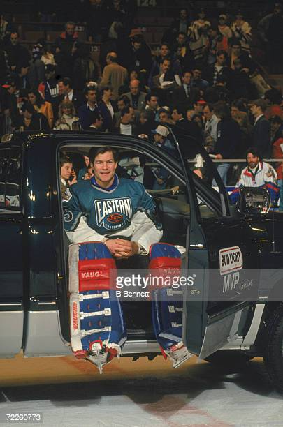 Goalie Mike Richter of the Eastern Conference and the New York Rangers sits inside of the pickup truck he won for being named the most valuable...