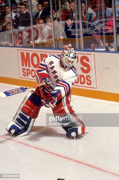 Goalie Mike Richter of the New York Rangers clears the puck during an NHL game in October 1993 at the Madison Square Garden in New York New York