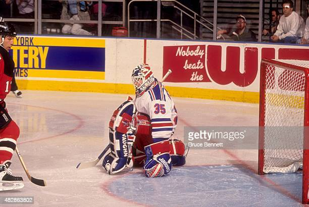 Goalie Mike Richter of the New York Rangers defends the net during Game 1 of the 1994 Eastern Conference Finals against the New Jersey Devils on May...