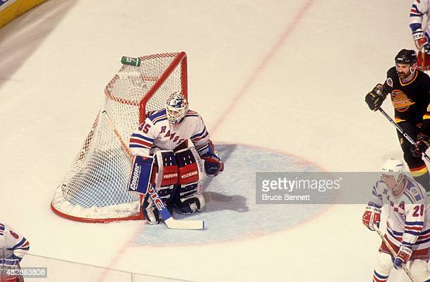 Goalie Mike Richter of the New York Rangers defends the net during Game 7 of the 1994 Stanley Cup Finals against the Vancouver Canucks on June 14...
