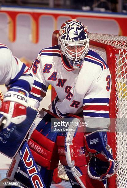 Goalie Mike Richter of the New York Rangers defends the net during an NHL game in November 1993 at the Madison Square Garden in New York New York