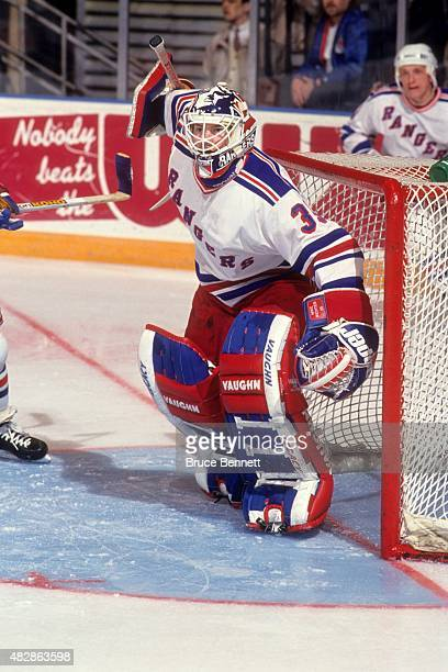 Goalie Mike Richter of the New York Rangers defends the net during an NHL game in March 1994 at the Madison Square Garden in New York New York
