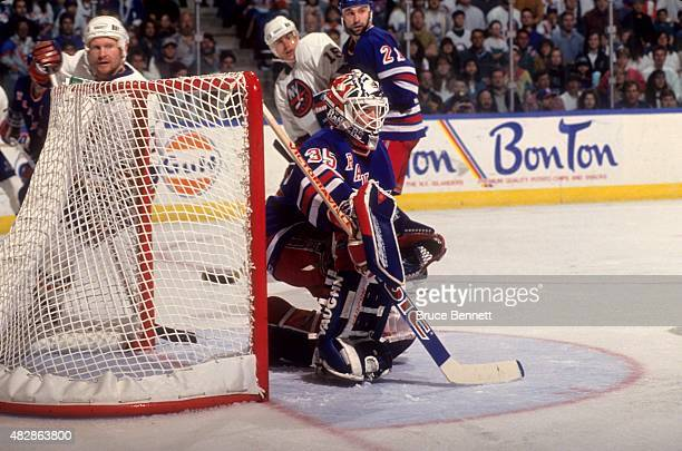 Goalie Mike Richter of the New York Rangers defends the net during an NHL game against the New York Islanders on April 10 1994 at the Nassau Coliseum...