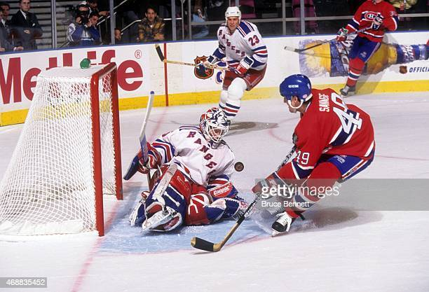 Goalie Mike Richter of the New York Rangers looks to make the save on Brian Savage of the Montreal Canadiens circa 1998 at the Madison Square Garden...