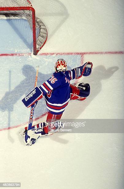 Goalie Mike Richter of the New York Rangers looks to make the save during an NHL game in March 1994