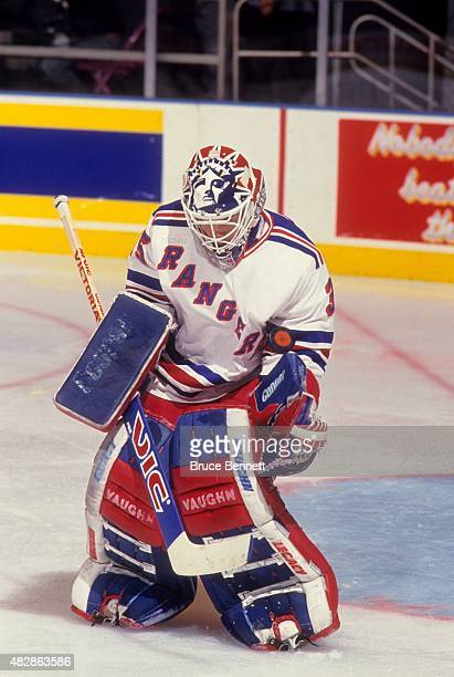 Goalie Mike Richter of the New York Rangers makes the save during an NHL game in November 1993 at the Madison Square Garden in New York New York