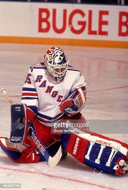 Goalie Mike Richter of the New York Rangers makes the save during an NHL game circa 1994 at the Madison Square Garden in New York New York