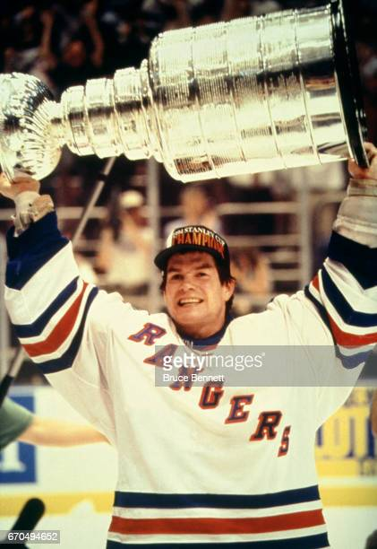 Goalie Mike Richter of the New York Rangers skates on the ice with the Stanley Cup Trophy after the Rangers defeated the Vancouver Canucks in Game 7...