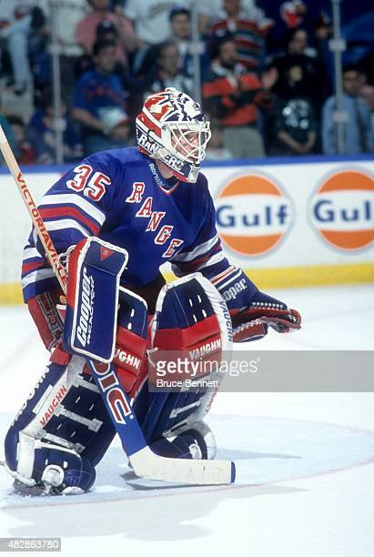 Goalie Mike Richter of the New York Rangers stands in the crease during an NHL game against the New York Islanders on March 5 1994 at the Nassau...