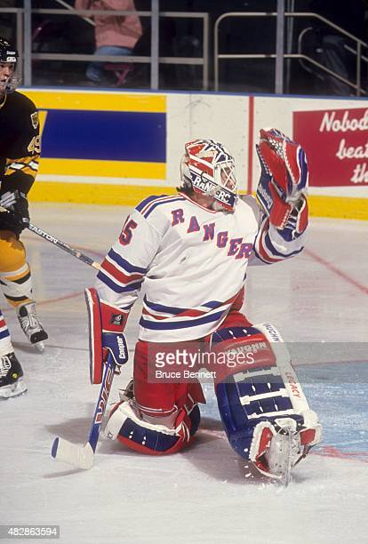 Goalie Mike Richter of the New York Rangers tries to make the save during an NHL game against the Boston Bruins on February 23 1994 at the Madison...