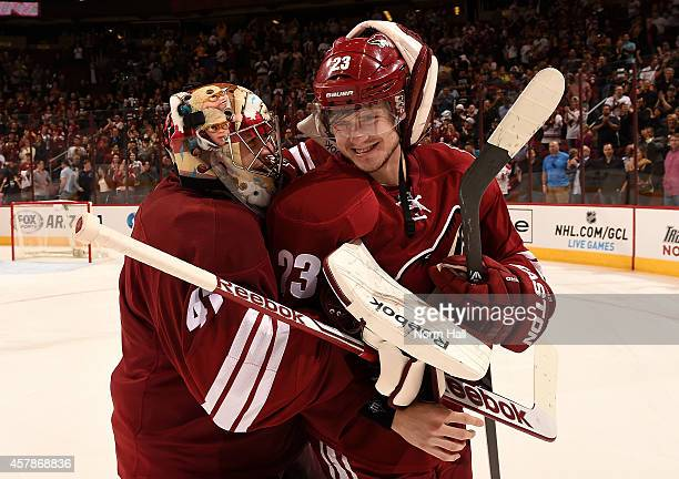 Goalie Mike Smith hugs defenseman Oliver EkmanLarsson of the Arizona Coyotes after EkmanLarsson scored the game winning goal in overtime during the...
