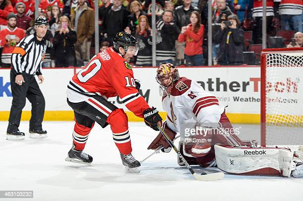 Goalie Mike Smith of the Arizona Coyotes blocks the shot taken by Patrick Sharp of the Chicago Blackhawks in the shootout during the NHL game at the...