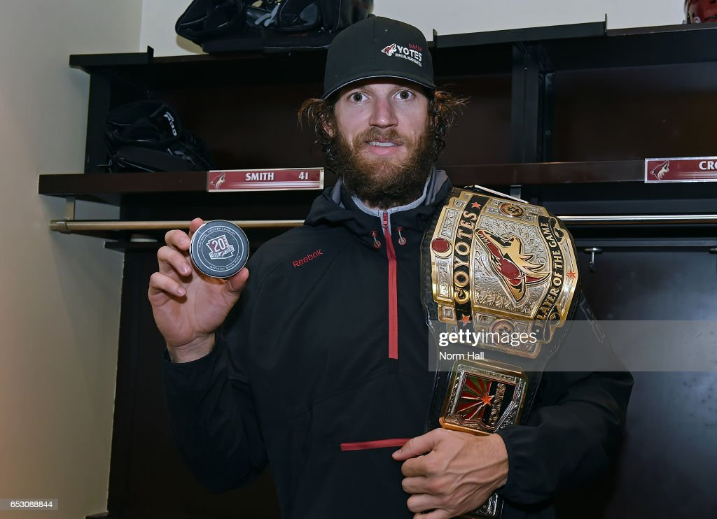 Goalie Mike Smith #41 of the Arizona Coyotes holds the game puck from his 1-0 shutout victory against the Colorado Avalanche at Gila River Arena on March 13, 2017 in Glendale, Arizona. The shutout was a franchise record 22nd for Smith.