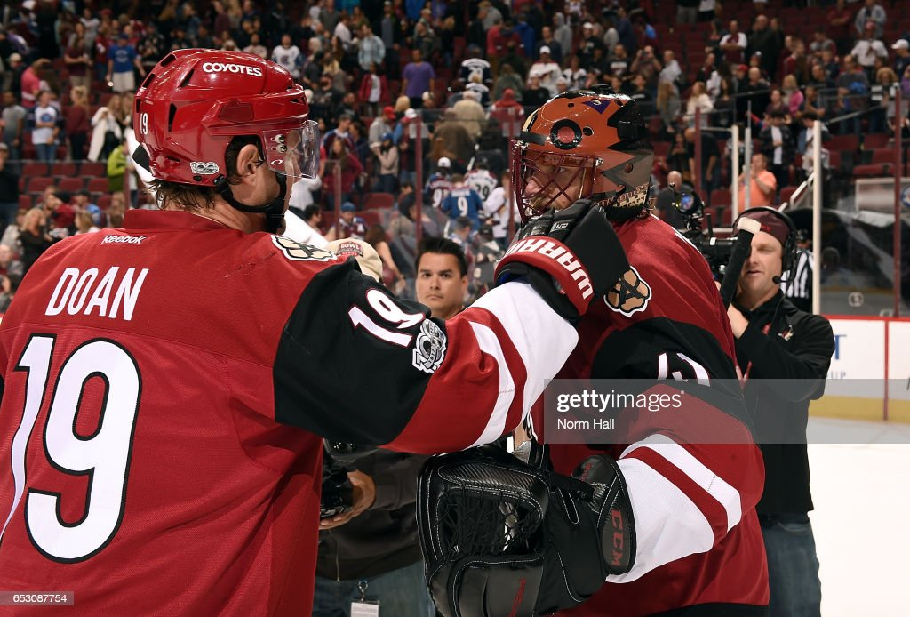 Goalie Mike Smith #41 of the Arizona Coyotes is congratulated by teammate Shane Doan #19 after a 1-0 victory against the Colorado Avalanche at Gila River Arena on March 13, 2017 in Glendale, Arizona. The shutout was a franchise record 22nd for Smith.
