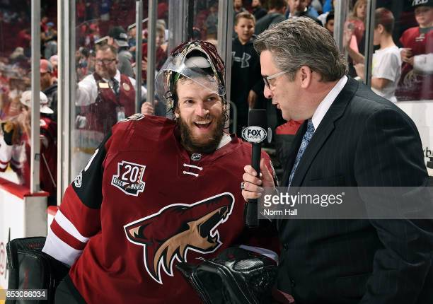 Goalie Mike Smith of the Arizona Coyotes is interviewed by the local Fox affiliate after recording a franchise record 22nd shutout in a 10 victory...