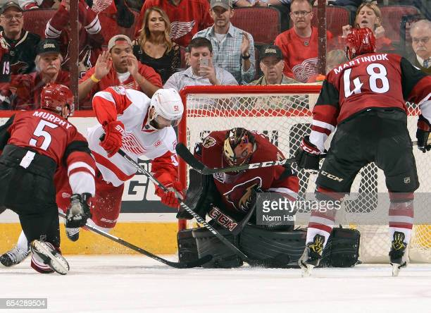 Goalie Mike Smith of the Arizona Coyotes makes a pad save on the scoring attempt by Frans Nielsen of the Detroit Red Wings as Connor Murphy and...
