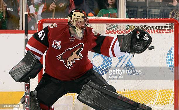 Goalie Mike Smith of the Arizona Coyotes reaches out to make a glove save on a shot by the Edmonton Oilers during the third period at Gila River...
