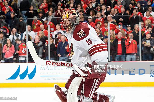Goalie Mike Smith of the Arizona Coyotes reacts after the Coyotes defeated the Chicago Blackhawks 32 during the NHL game at the United Center on...