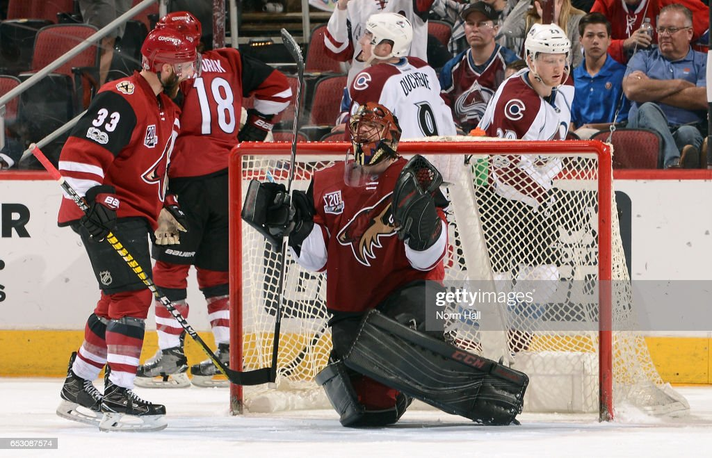 Goalie Mike Smith #41 of the Arizona Coyotes reacts next to teammate Alex Goligoski #33 after recording a franchise record 22nd shutout in a 1-0 victory against the Colorado Avalanche at Gila River Arena on March 13, 2017 in Glendale, Arizona.