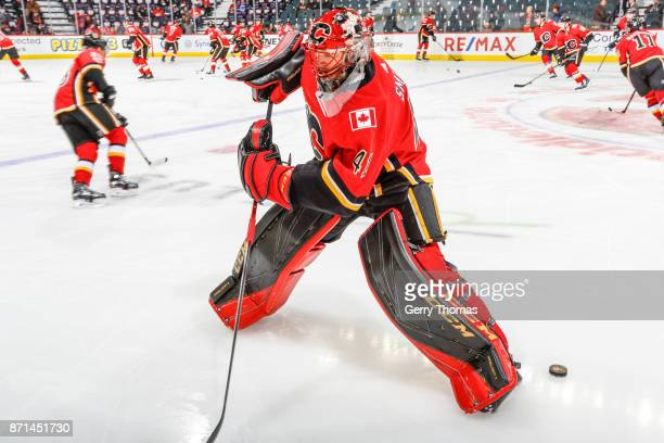 Goalie Mike Smith of the Calgary Flames at warm up in an NHL game against the Vancouver Canucks at the Scotiabank Saddledome on November 7 2017 in...