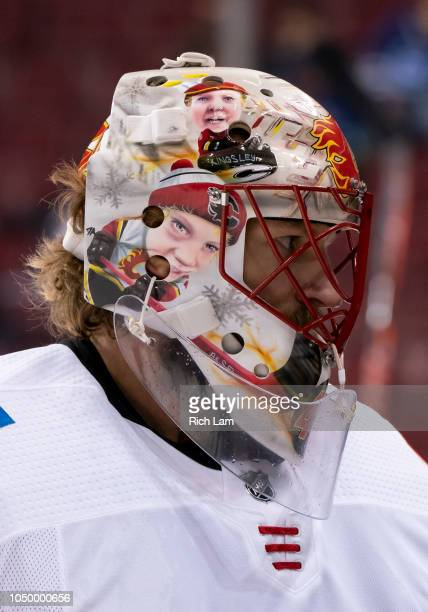 Goalie Mike Smith of the Calgary Flames during the pre-game warmup prior to NHL action against the Vancouver Canucks on October 2018 at Rogers Arena...