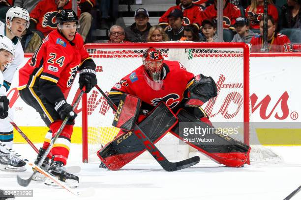 Goalie Mike Smith of the Calgary Flames is under fire in a game against the San Jose Sharks at the Scotiabank Saddledome on December 14 2017 in...