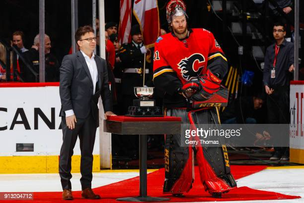 Goalie Mike Smith of the Calgary Flames receives an award in an NHL game on February 1 2018 at the Scotiabank Saddledome in Calgary Alberta Canada