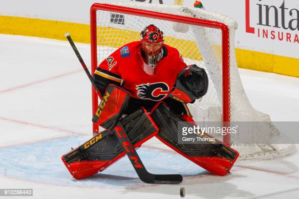 Goalie Mike Smith of the Calgary Flames stops a puck in an NHL game on January 22 2018 at the Scotiabank Saddledome in Calgary Alberta Canada