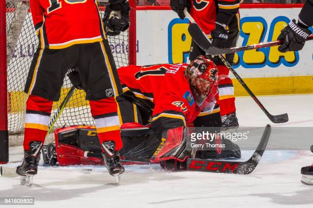Goalie Mike Smith of the Calgary Flames under friendly fire in an NHL game on April 3 2018 at the Scotiabank Saddledome in Calgary Alberta Canada