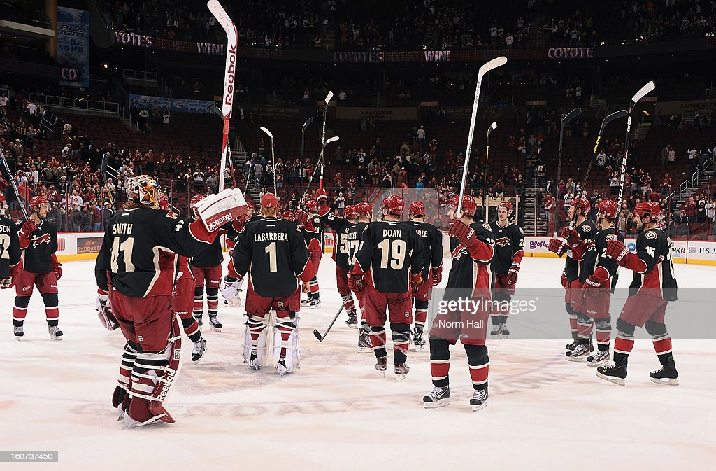 Goalie Mike Smith #41 of the Phoenix Coyotes and teammates salute the fans following their 2-1 victory over the Minnesota Wild at Jobing.com Arena on February 4, 2013 in Glendale, Arizona.