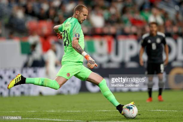 Goalie Milan Borjan of Canada clears the ball down the pitch against Mexico in the second half during group play in the CONCACAF Gold Cup at Sports...