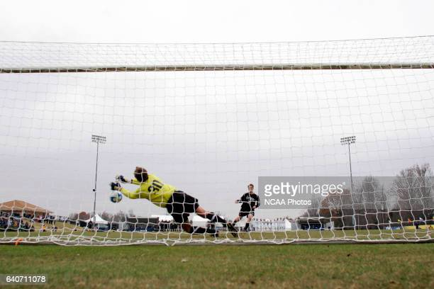 Goalie Nick Blosey of Messiah College makes a save during the shoot out against the Stevens Institute of Technology during the Division III Men's...
