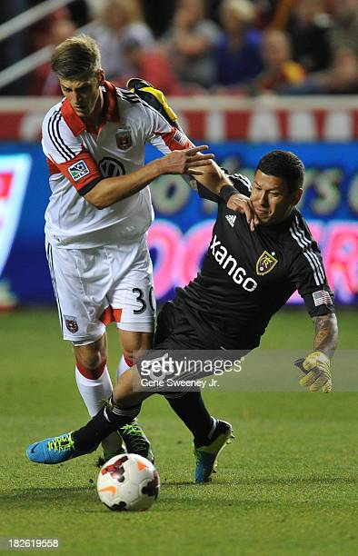 Goalie Nick Rimando of Real Salt Lake is knocked over by Conor Doyle of D C United at Rio Tinto Stadium October 1 2013 in Sandy Utah