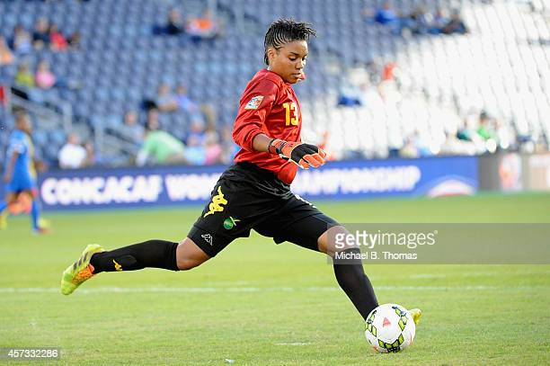 Goalie Nicole McClure of Jamaica clears the ball against Martinique during the CONCACAF Women's Championship USA 2014 at Sporting Park on October 16...