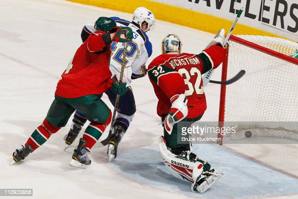 Goalie Niklas Backstrom of the Minnesota Wild reacts as the shot of Alex Pietrangelo of the St Louis Blues deflects into the net for a goal during...