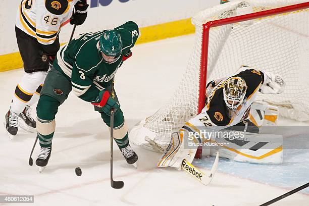 Goalie Niklas Svedberg of the Boston Bruins defends against Charlie Coyle of the Minnesota Wild during the game on December 17 2014 at the Xcel...