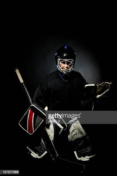 goalie on a black background - ice hockey player stock pictures, royalty-free photos & images