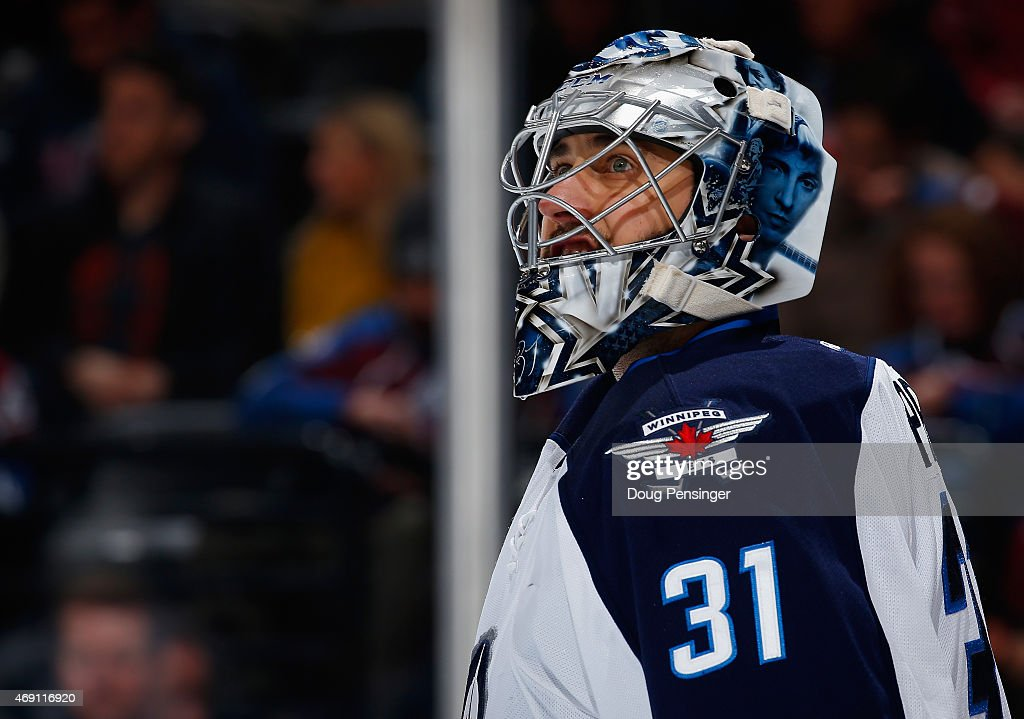 Goalie Ondrej Pavelec #31 of the Winnipeg Jets looks on during a break in the action as he defends the goal against the Colorado Avalanche at Pepsi Center on April 9, 2015 in Denver, Colorado. The Avalanche defeated the Jets 1-0 in an overtime shootout.