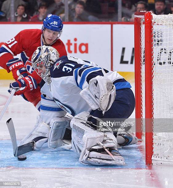 Goalie Ondrej Pavelec of the Winnipeg Jets makes a pad save during the NHL game against the Montreal Canadiens on April 4 2013 at the Bell Centre in...