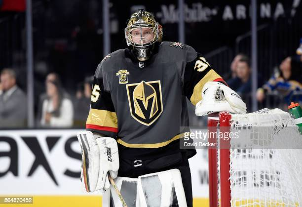 Goalie Oscar Dansk of the Vegas Golden Knights looks on against the St Louis Blues at TMobile Arena on October 21 2017 in Las Vegas Nevada